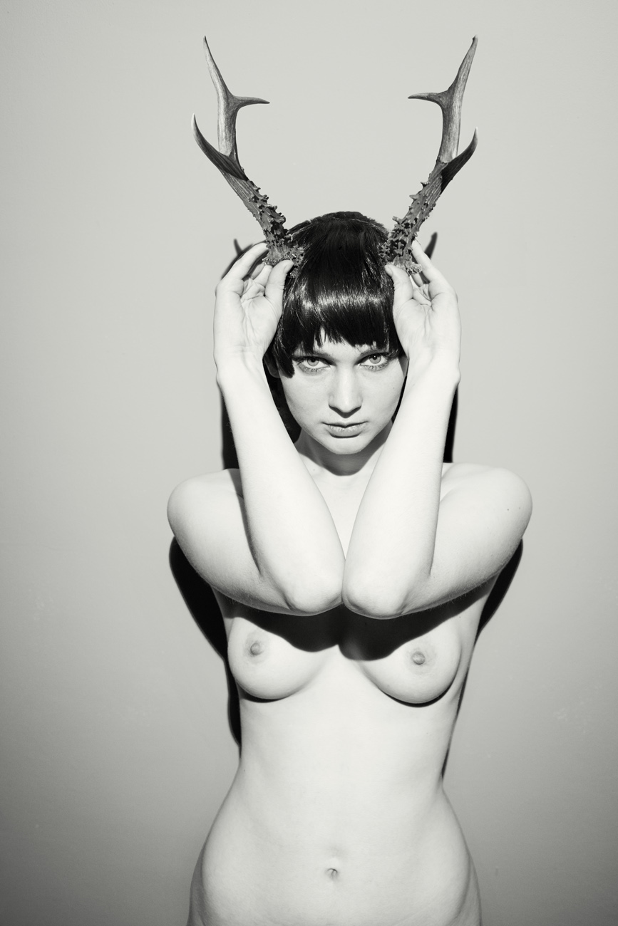 nude female model as mythical god cerynitis with antlers