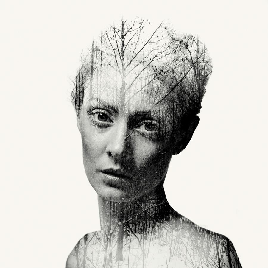 nude double exposure of a woman with branches